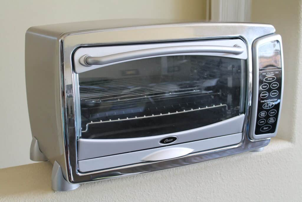 Oster TSSTTVMNDG Toaster Oven closed on a counter.