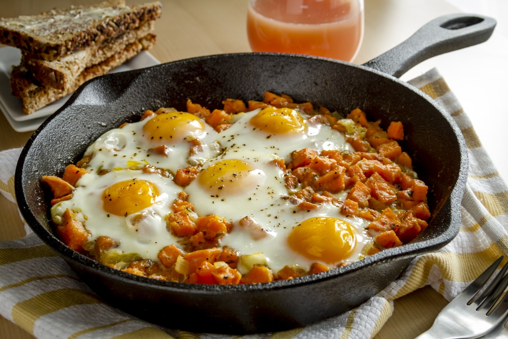 Eggs and yams on cast iron skillet